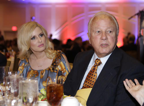 FILE - Former Louisiana governor Edwin Edwards and his wife Trina Scott Edwards attend a luncheon for a Council For a Better Louisiana in Baton Rouge, La., in this Dec. 12, 2012 file photo. Edwards' wife, Trina, has given birth to a baby boy Thursday Aug. 1, 2013 at 12:52 a.m. according to a post on Trina Scott Edwards' Facebook page. This will be the third child for Trina and the fifth for Edwin, but it's the couple's first together. They've been married for two years. (AP Photo/Gerald Herbert, File)