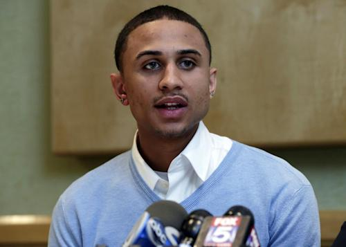 "Sheldon Stephens speaks at a news conference in New York, Tuesday, March 19, 2013. Stephens, 24, of Harrisburg, Pa., has filed suit against Kevin Clash, former voice of the ""Sesame Street"" character Elmo, claiming the entertainer lured him into drug-fueled sex when he was 16. (AP Photo/Richard Drew)"