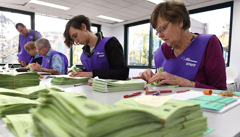 AEC employees pictured counting the votes in the federal election. Source: Getty