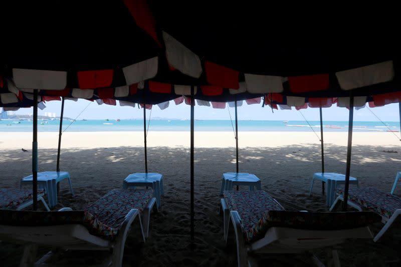Empty chairs are seen on a beach amid fears of coronavirus disease (COVID-19) in Pattaya