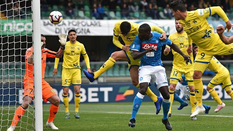 Two goals from Kalidou Koulibaly (C) helped Napoli condemn Chievo to relegation with a 3-1 victory