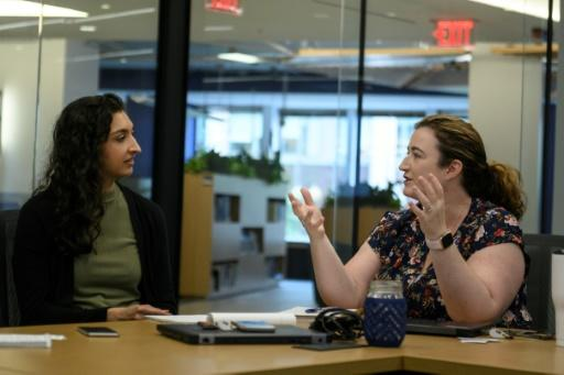 Lacey Malarky (L) and Beth Lowell, of Oceana, talk at the headquarters in Washington