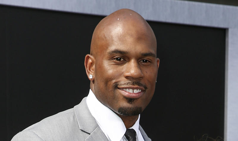 """FILE - In this June 28, 2015, file photo, WWE wrestler Shad Gaspard arriving at the Los Angeles premiere of """"Terminator Genisys"""" at the Dolby Theatre in Los Angeles. The former World Wrestling Entertainment pro remained missing Tuesday, May 19, 2020 after being swept out to sea while swimming with his young son over the weekend off Southern California, police said. Gaspard's 10-year-old son Aryeh was rescued and several other swimmers made it out of the water safely after they were caught in a rip current Sunday afternoon at Venice Beach in Los Angeles. (Photo by Rich Fury/Invision/AP, File)"""