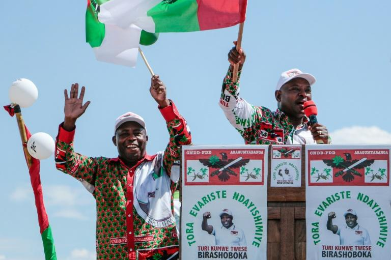 On the campaign trail: Pierre Nkurunziza, right, with his successor Evariste Ndayishimiye at an election rally on May 16