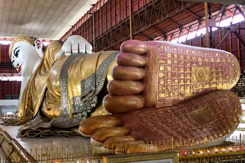 This December 2012 photo shows a reclining Buddha decorated in gold leaf at the Chaykhtatgyi Pagoda, in Mandalay, in Myanmar. (AP Photo/Richard Camp)