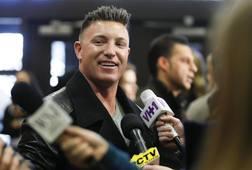 "Cast member Lane Garrison is interviewed at the premiere of the film ""Camp X-Ray"" during the 2014 Sundance Film Festival, on Friday, Jan. 17, 2014 in Park City, Utah. (Photo by Danny Moloshok/Invision/AP)"