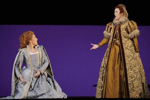 In this April 18, 2012, photo provided by the Houston Grand Opera, Joyce DiDonato, left, performs in the Houston Grand Opera's production of Maria Stuarda, with Katie Van Kooten, right, in Houston. Though the role has often been taken by sopranos who dazzle the audience with their high notes, DiDonato performs a lower-voiced alternate version, which can be just as satisfying. (AP Photo/Houston Grand Opera)