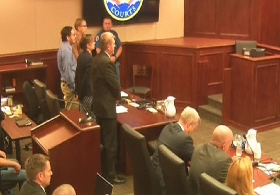 Holmes stands in court as the verdict is read in Denver