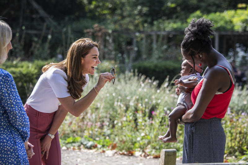 LONDON, ENGLAND - SEPTEMBER 22: Catherine, Duchess of Cambridge meets with MUSH mother and baby group member, Morgan Alex Cassius and her 6 month old, Makena Grace as she hears from families and key organisations about the ways in which peer support can help boost parent wellbeing while spending the day learning about the importance of parent-powered initiatives, in Battersea Park on September 22, 2020 in London, England. (Photo by Jack Hill - WPA Pool/Getty Images)