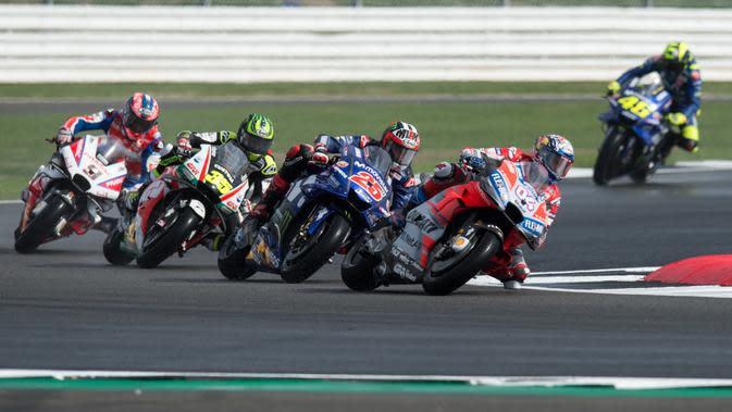 Ilustrasi persaingan MotoGP. (OLI SCARFF / AFP)