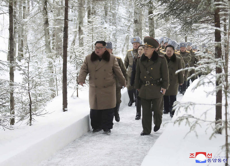 "This undated photo provided on Wednesday, Dec. 4, 2019, by the North Korean government shows North Korean leader Kim Jong Un, center, visits Mount Paektu area, North Korea. North Korea says leader Kim has taken a second ride on a white horse to a sacred mountain in less than two months. Independent journalists were not given access to cover the event depicted in this image distributed by the North Korean government. The content of this image is as provided and cannot be independently verified. Korean language watermark on image as provided by source reads: ""KCNA"" which is the abbreviation for Korean Central News Agency. (Korean Central News Agency/Korea News Service via AP)"