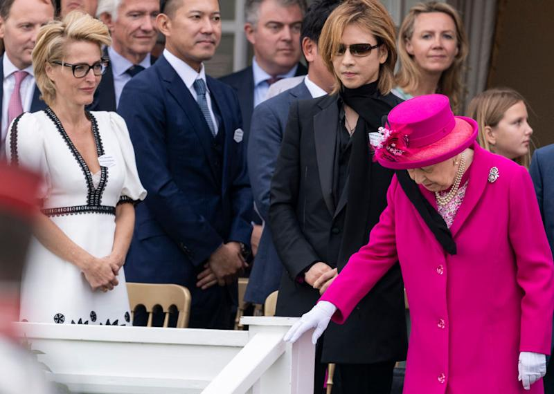 Queen Elizabeth II and Gillian Anderson attend The Royal Windsor Cup Final at Guards Polo Club on June 23, 2019 in Egham, England.