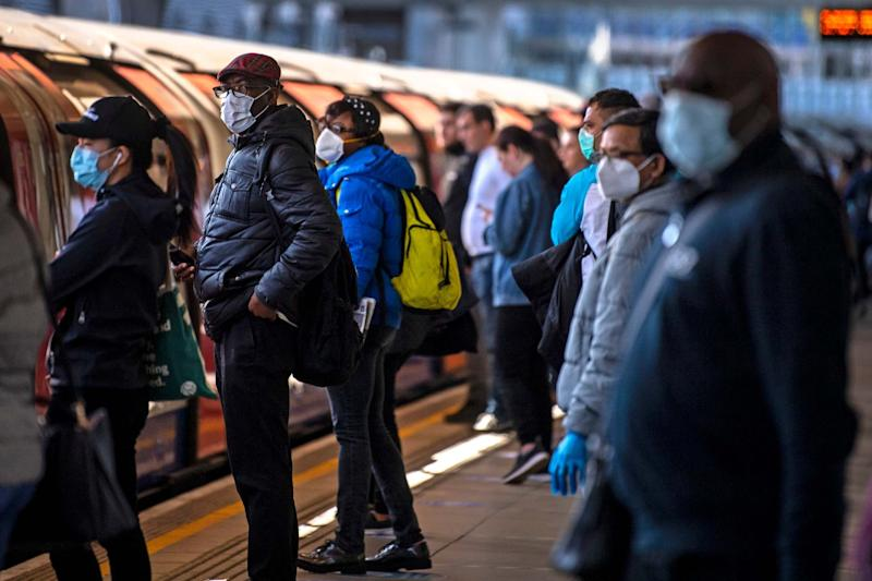 Face coverings are mandatory on public transport in England (PA)