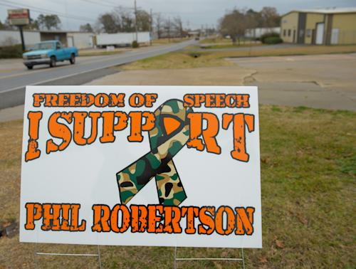 "This Dec. 21, 2013 photo shows a sign in West Monroe, La., supporting Phil Robertson, the patriarch of the popular ""Duck Dynasty"" series. Robertson was suspended last week for disparaging comments he made to GQ magazine about gay people. (AP Photo/Matthew Hinton)"