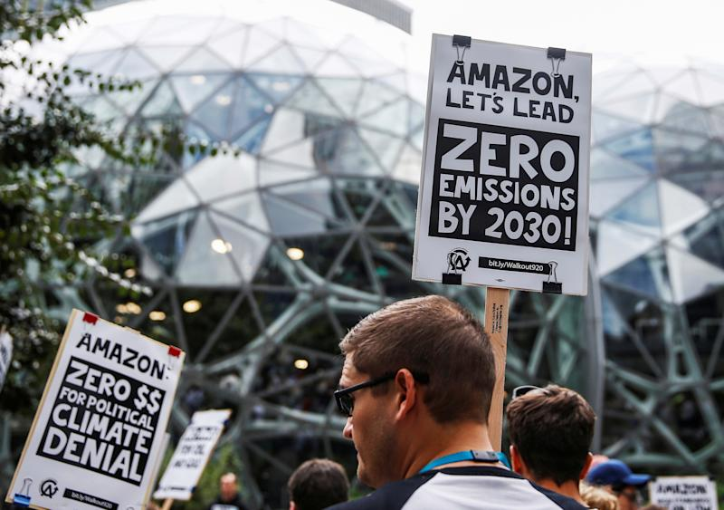 An attendee holds a sign asking Amazon to reach zero emissions by 2030 outside the Amazon Spheres during a Climate Strike walkout and march in Seattle, Washington, U.S. September 20, 2019. REUTERS/Lindsey Wasson TPX IMAGES OF THE DAY
