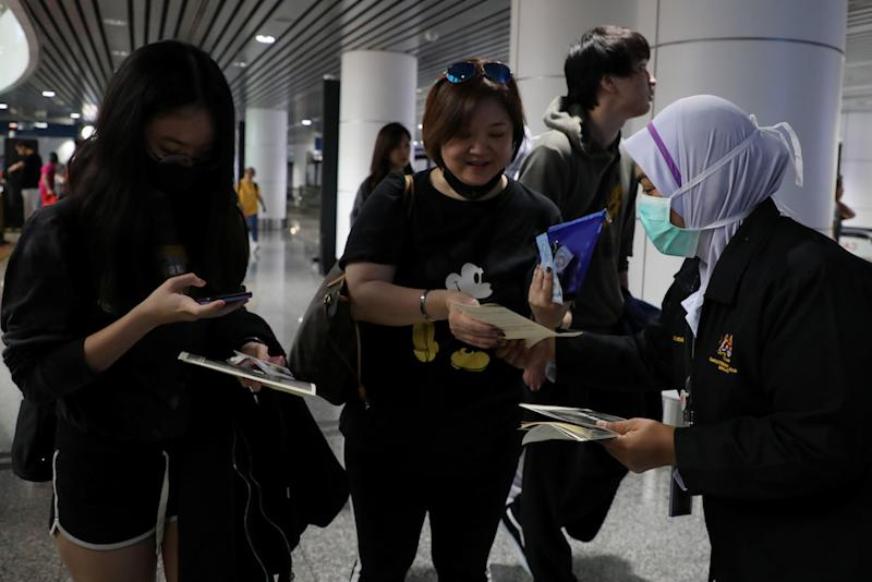 Malaysians returning from abroad will still have to go through a health screening and will be subjected to monitoring by the authorities. — Reuters pic