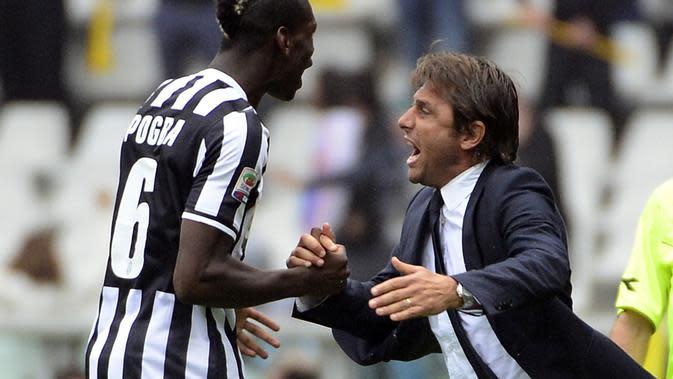 Paul Pogba dan Antonio Conte saat masih bekerja sama di Juventus. (OLIVIER MORIN / AFP)