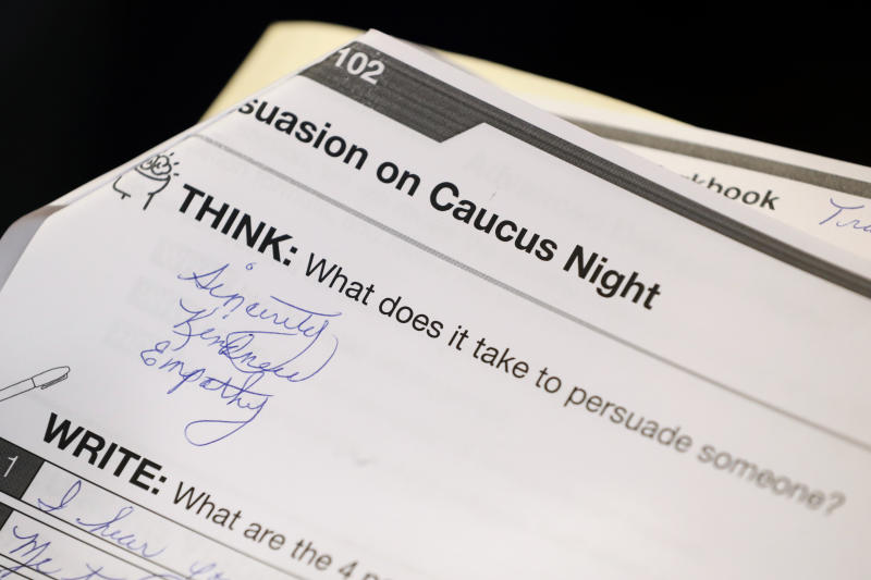 FILE - In this Jan. 9, 2020, file photo, a question in a training booklet is seen during a caucus training meeting at the local headquarters for Democratic presidential candidate former South Bend, Ind., Mayor Pete Buttigieg in Ottumwa, Iowa. (AP Photo/Charlie Neibergall)