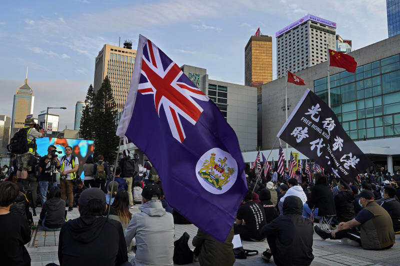 "Protesters carry a Hong Kong flag and a flag that reads ""Hong Kong Independence"" during a rally in Hong Kong, Sunday, Jan. 12, 2020. More than a thousand people attended a Sunday rally in Hong Kong to urge people and governments abroad to support the territory's pro-democracy movement and oppose China's ruling Communist Party. (AP Photo/Vincent Yu)"