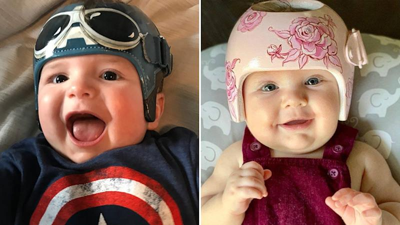 Two babies with painted helmets. An aviator design (left) and a floral design right. Source: @LazardoArt