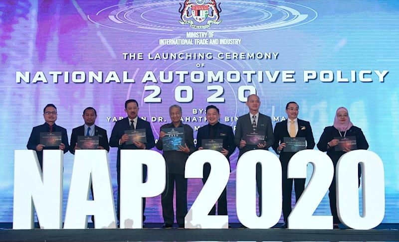Prime Minister Tun Dr Mahathir Mohamad (fourth left) during the launch of the National Automotive Policy 2020 at Menara Miti in Kuala Lumpur February 21, 2020. — Bernama pic
