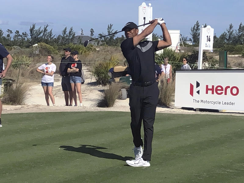 Tiger Woods hits 3-wood off the seventh tee at Albany Golf Club in the first round of the Hero World Challenge on Wednesday, Dec. 4, 2019, in Nassau, Bahamas. Woods used the opening round to pair several of his Presidents Cup players together. (AP Photo/Doug Ferguson)
