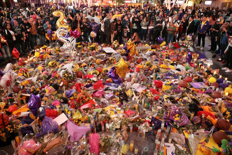 FILE PHOTO: Mourners gather outside Staples Center before a Los Angeles Lakers home game to pay respects to Kobe Bryant