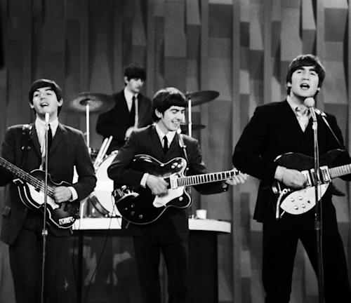 "FILE - In this Feb. 9, 1964 file photo, The Beatles , from left, Paul McCartney, Ringo Starr on drums, George Harrison and John Lennon, perform on the CBS ""Ed Sullivan Show"" in New York. The Beatles made their first appearance on ""The Ed Sullivan Show,"" America's must-see weekly variety show, on Sunday, Feb. 9, 1964. And officially kicked off Beatlemania. (AP Photo/Dan Grossi/ File)"