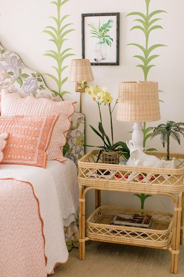 """<p>The queen of rattan, interior designer <a href=""""https://www.veranda.com/home-decorators/a32128482/amanda-lindroth-new-furniture-collection/"""" target=""""_blank"""">Amanda Lindroth</a>, lets her <a href=""""https://amandalindroth.com/products/lyford-bar-table?_pos=2&_sid=a0e067aa3&_ss=r"""" target=""""_blank"""">Lyford bar table</a> from her brand-new <a href=""""https://amandalindroth.com/collections/amanda-lindroth-home"""" target=""""_blank"""">furniture collection</a> serve more than one purpose — like as an island-chic nightstand. </p><p>""""I have been fascinated by people's night tables since I was a young girl. Doesn't it just say so much about a person by what is on their night table?"""" says the Bahamas-based Lindroth. </p><p>""""When we dress night tables for clients, we have a cup with matching pens and a stack of notecards or little tablets, a carafe of water with a glass with a pretty linen napkin on a rattan or lacquer tray, [and] an orchid in a rattan basket or a tiny posy of flowers from the garden."""" </p><p>This handwoven table's design was inspired by a vintage piece the designer has at her home, Hope Hill.  <br></p>"""