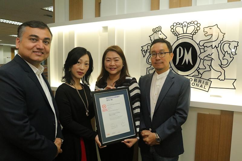 Chinmay Sharma (director people and culture), Amba Chan (director of finance), Veronica Choo (head of corporate communications) and Kang Tae Koo (managing director, Philip Morris Malaysia) pose with the Equal-Salary certificate.
