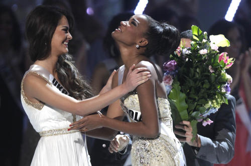Miss Angola Leila Lopes, right, and Miss Ukraine Olesia Stefanko react after Lopes was named Miss Universe 2011 and Stefanko first runner up at the Miss Universe pageant in Sao Paulo, Brazil, Monday Sept. 12, 2011. (AP Photo/Andre Penner)