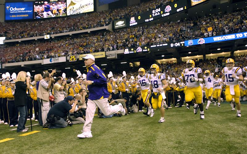 Les Miles, then-head coach of the LSU Tigers, runs onto the field with his team before a game against Ohio State in the 2008 BCS national title game at the Superdome on Jan. 7, 2008. LSU defeated the Buckeyes 38-24. (LSU/Getty)