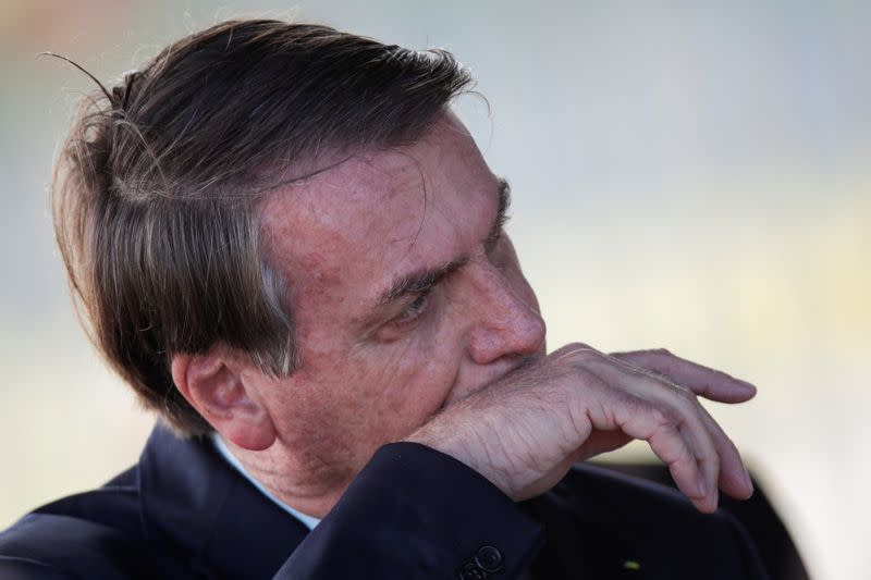 Brazil's President Jair Bolsonaro gestures while meets supporters as he leaves Alvorada Palace, as the spread of coronavirus disease (COVID-19) continues, in Brasilia