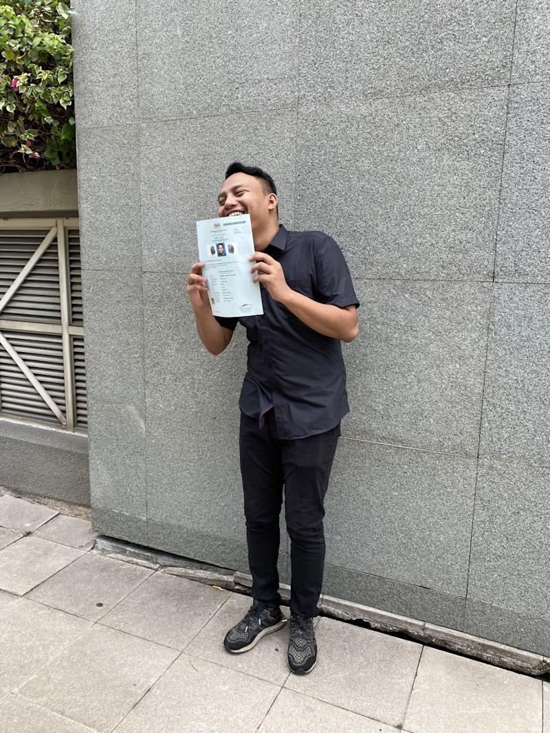 Aiman and his long-awaited official paper certifying that he is a Malaysian citizen. ― Picture courtesy of Lee Yee Woei