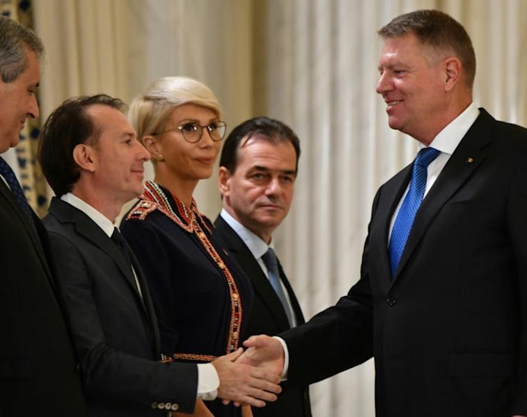 Romanian president Klaus Iohannis (R, pictured November 2019) shakes hands with Florin Citu