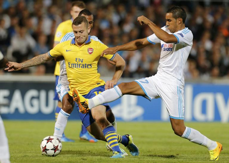 Arsenal's Wilshere challenges Olympique Marseille's Payet during their Group F Champions League soccer match at the Velodrome stadium in Marseille