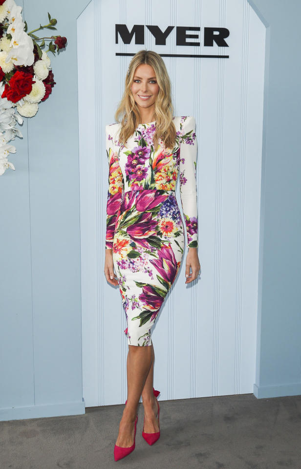 <p>Jennifer Hawkins arrives at Myer's tent in The Park at Flemington in an Alex Perry midi dress teamed with bright pink heels. <br />Photo: Media Mode </p>