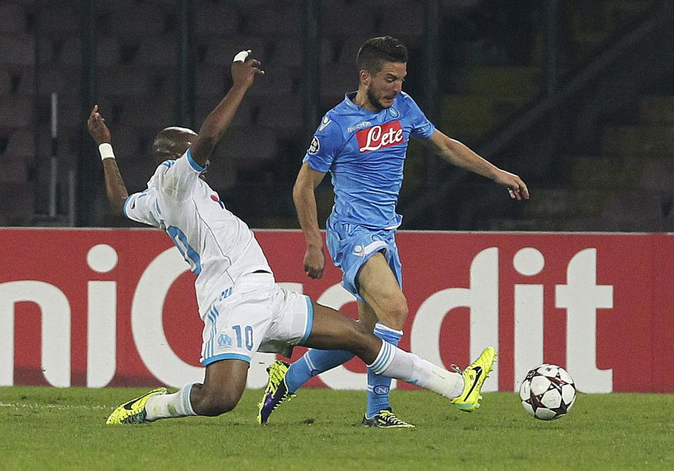 Olympique Marseille's Ayew challenges Napoli's Mertens during their Champions League soccer match at San Paolo stadium in Naples