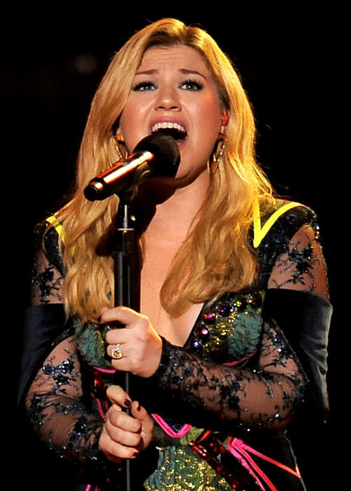 "FILE - In this Dec. 16, 2012 file photo, Kelly Clarkson performs at VH1 Divas at the Shrine Auditorium in Los Angeles. Kelly Clarkson's No. 1 hit, ""Stronger (What Doesn't Kill You),"" is nominated for record of the year at Grammy Awards on Feb. 10, 2013. The song is also up for song of the year and best pop solo performance, and her fifth album, ""Stronger,"" is nominated for best pop vocal album. (Photo by Chris Pizzello/Invision/AP, File)"