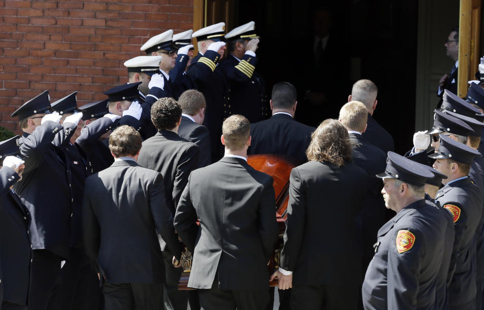 An honor guard from area fire departments salute as pallbearers carry the casket of Boston Marathon bomb victim Krystle Campbell, 29, into St. Joseph's Church for her funeral in Medford, Mass. Monday, April 22, 2013. (AP Photo/Elise Amendola)
