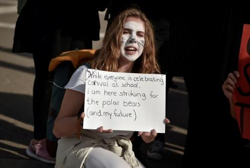 Protest: A student at a demonstration against climate change in Athens last Friday