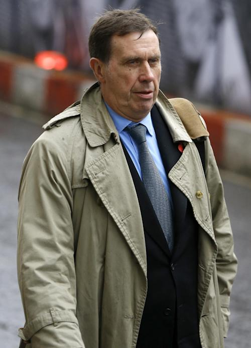 Former Royal Editor Clive Goodman arrives at The Old Bailey law court in London, Thursday, Oct. 31, 2013. Former News of the World national newspaper editors Rebekah Brooks and Andy Coulson went on trial Monday, along with several others, on charges relating to the hacking of phones and bribing officials while they were employed at the now closed tabloid paper. (AP Photo/Kirsty Wigglesworth)