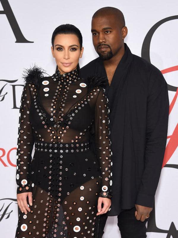 Kim Kardashian dan Kanye West (AFP)