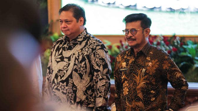 Menko Bidang Perekonomian Airlangga Hartarto dan Menteri Pertanian Syahrul Yasin Limpo menghadiri peresmian pembukaan Asian Agriculture and Food Forum (ASAFF) 2020 di Istana Negara, Jakarta, Rabu (12/3/2020). Perhelatan tersebut dibuka langsung oleh Presiden Joko Widodo. (Liputan6.com/Faizal Fanani)