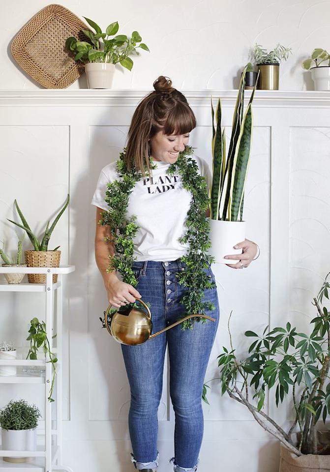 """<p>Trade a basic cat costume for this quick and easy look. Simply, drape some faux greens around your neck like a boa, and throw on a t-shirt that highlights your obsession. </p><p><a class=""""body-btn-link"""" href=""""https://www.amazon.com/Artiflr-Artificial-Eucalyptus-Greenery-Decorations/dp/B07M8Q2T5Y/r?tag=syn-yahoo-20&ascsubtag=%5Bartid%7C10055.g.33393477%5Bsrc%7Cyahoo-us"""" target=""""_blank"""">SHOP FAUX GREEN GARLAND</a></p><p><a href=""""https://themerrythought.com/halloween-2/diy-plant-lady-costume/"""" target=""""_blank""""><em>Get the tutorial at The Merrythought »</em></a><br></p>"""