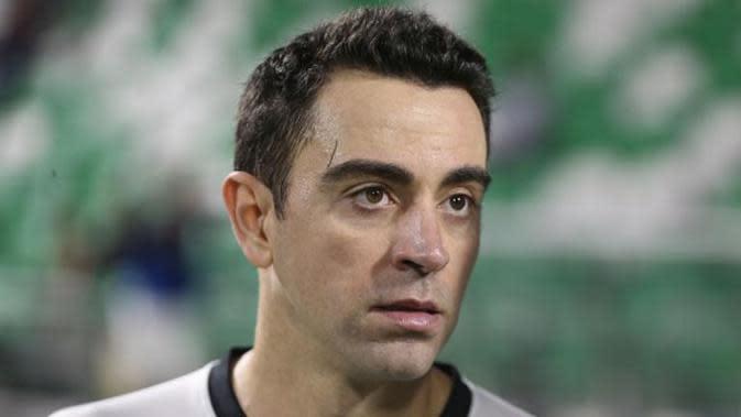 Xavi Hernandez memiliki mimpi melatih Barcelona suatu saat nanti. (AFP/Karim Jaafar)