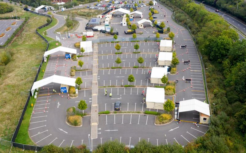 An almost-empty test centre in Guildford on Wednesday - CHRIS GORMAN