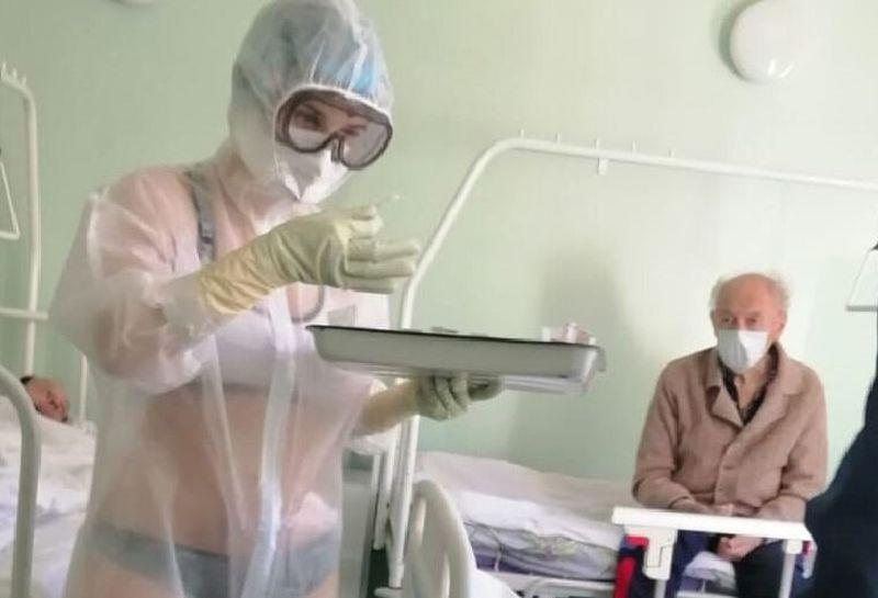 The viral image of a Russian nurse in what appears to be a bikini treating Covid-19 patients in a male-only ward. — Picture via Twitter/_MariettaDavis