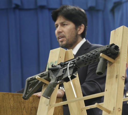 """A homemade fully automatic rifle is displayed at a news conference by State Sen. Kevin de Leon, D-Los Angeles, where he unveiled legislation dealing with so called """"ghost guns,"""" at the Capitol in Sacramento, Calif., Monday, Jan. 13, 2014. Under de Leon's proposed legislation, SB808 would allow the manufacture or assembly of homemade weapons, but require the makers to first apply to the state Department of Justice for a serial number that would be given only after the applicants undergo a background check. De Leon plans to amend the bill to also require that guns contain permanent pieces of metal that could be detected by X-ray machines and metal detectors. .(AP Photo/Rich Pedroncelli)"""