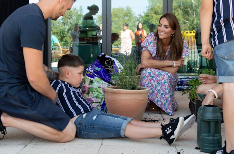 EMBARGOED: No onward transmission before 2100 BST Sat 27/6/2020. Not for publication before 2200 BST Sat 27/6/2020. The Duchess of Cambridge talks with Sonny Saunders (seated left) and his father, Jordan, during a visit to The Nook in Framlingham Earl, Norfolk, which is one of the three East Anglia Children's Hospices (EACH). Sonny was diagnosed with a diffuse intrinsic pontine glioma, an aggressive and difficult-to-treat brain tumour, only a week or so after his sixth birthday in February.